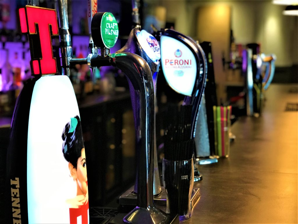 beer taps in the sports bar at the steelworks bar and grill motherwell